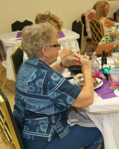 Penny Clark eats dinner at the Ladies Auxiliary celebration Monday evening. Jillian Danielson/RiverScene