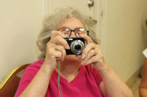 Audrey Steffan takes photos at the dinner Monday evening. Jillian Danielson/RiverScene