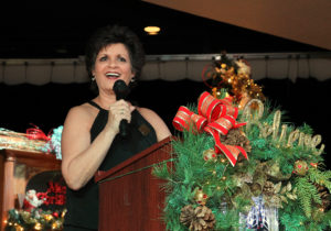 Connie Alexander speaks at the Christmas Tree Raffle Sunday afternoon. Jillian Danielson/RiverScene
