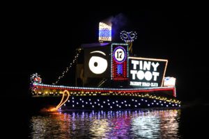 Tiny Toot rides through the Channel during the Boat Parade of Lights. Jillian Danielson/RiverScene