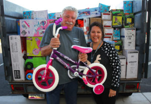 Bill Rozhon and Shelly Keirns pose with toys they donated Tuesday afternoon. Jillian Danielson/RiverScene