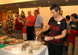 """Linda Rohn pours punch Wednesday evening at the """"Party Among The Trees."""" Jillian Danielson/RiverScene"""