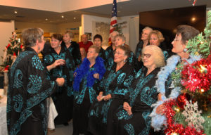 "The Colomonde Choir performs ""Santa Baby"" Wednesday evening. Jillian Danielson/RiverScene"