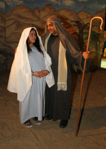 Aliya Smith and Kyle Neidermann pose for a photo as Mary and Joseph in the Live Nativity. Jillian Danielson/RiverScene