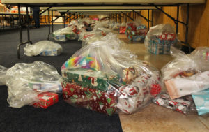 Presents for families are lined up under tables Friday morning at the Elks Lodge. Jillian Danielson/RiverScene