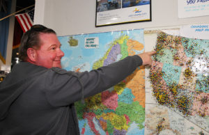 Visitor Larry Chambers points to a pin he just added to a map of his hometown of Eugene, Oregon. Jillian Danielson/RiverScene