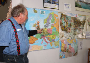 Jan Kassis points to his hometown on the map at the Visitors Center Wednesday. Jillian Danielson/RiverScene