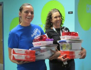 From left, Nautilus Elementary teachers Sarah Didion and Leah Branch react after HYAC presented their care packages.
