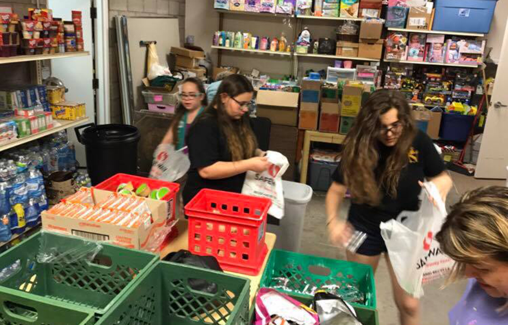 Girl Scouts Donate To H.A.V.E.N