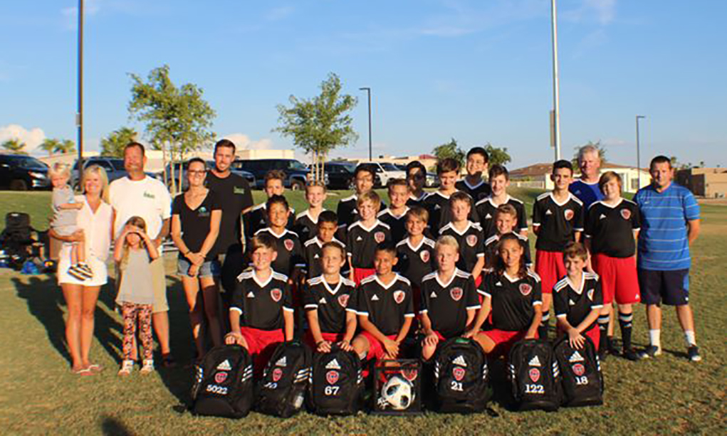 Local Builder Donates Backpacks To WVSC Players