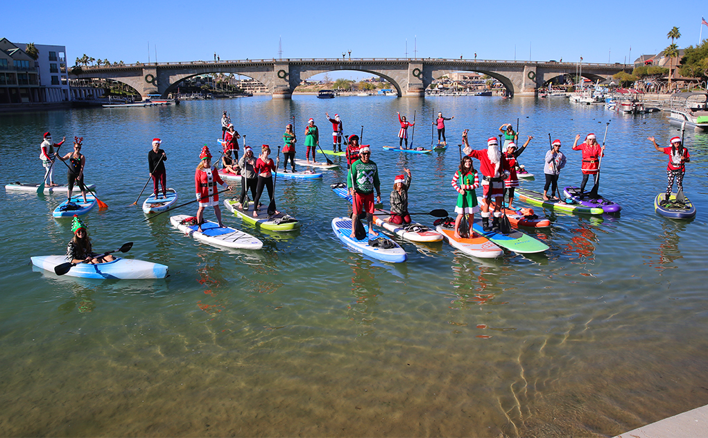 Santas And Elves Paddle Through Channel To Celebrate The Season