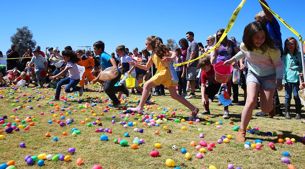 Children collect plastic eggs at the Sunrise Rotary Easter Egg Hunt Sunday. Jillian Danielson/RiverScen